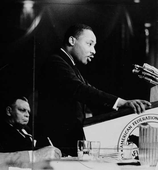 1112px-Dr._Martin_Luther_King,_Jr.,_speaking_at_an_AFL-CIO_event_(5279611540)